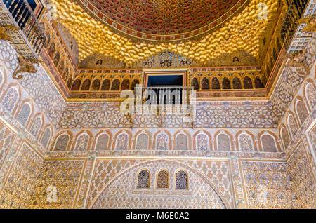 Seville, Spain - May 27, 2015: Moorish architecture inside the Alcazar - a royal palace in Seville, originally developed - Stock Photo