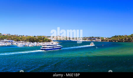 Captain Cook Ferry  going past Swan Yacht Club and East Fremantle on the Swan River as viewed from Mosman Park. - Stock Photo