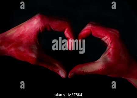 Human heart in hand with blood. broken heart concept - Stock Photo