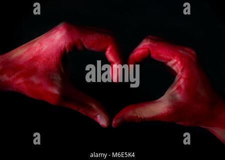 Human heart in hand with blood. broken heart concept