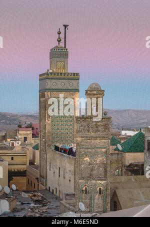 At right minaret of Sidi Lazaze, at left minaret of  Medersa Bou Inania, Medina, Fez, Morocco - Stock Photo
