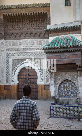 Place an-Nejjarine. In background, the brown door is the Art and wood crafts Museum . Fez.Morocco - Stock Photo