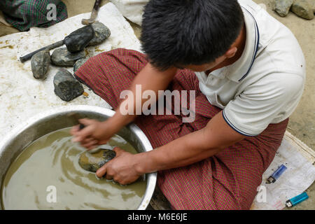 Mandalay: Jade Market, men cleaning stones, , Mandalay Region, Myanmar (Burma) - Stock Photo