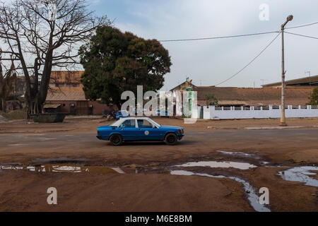Bissau, Republic of Guinea-Bissau - January 28, 2018: A taxi in the Amilcar Cabral Avenue (Avenida Amilcar Cabral) - Stock Photo