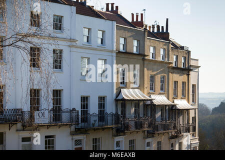 A terrace of Georgian houses with elegant iron balconies at Sion Hill, Clifton, Bristol, overlooking the Suspension - Stock Photo