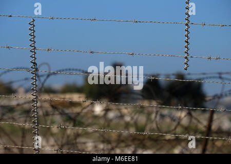 barbed wire of the border fence with Lebanon. Northern Israel - Stock Photo