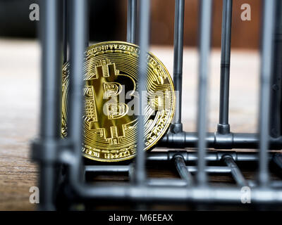The coin is in the gray nick color put on a wooden table. The concept of investment and fluctuation of bitcoin and - Stock Photo