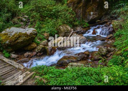A small stream on Annapurna trekking trail in Nepal. - Stock Photo