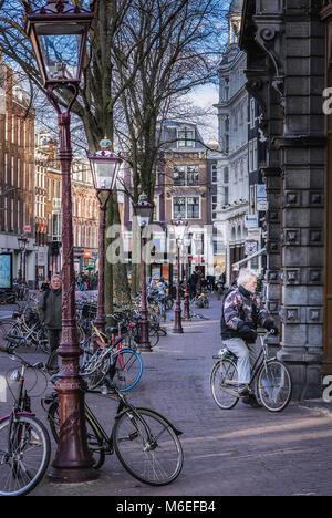 Man staring in window  in amsterdam - Stock Photo