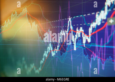 Graph charts of stock market investment trading - business background - Stock Photo