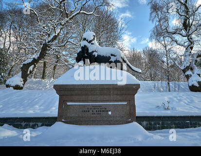 Statue of Lioness (with cubs and peacock) covered in snow on a sunny day Kelvingrove park glasgow - Stock Photo
