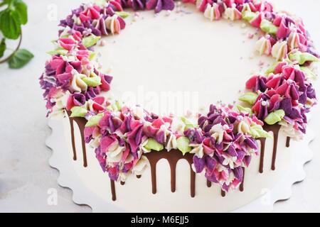 Festive cake with cream flowers hydrangea on a light background - Stock Photo