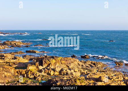 Picturesque Rocky beach of Atlantic Ocean in Matosinhos, City of Porto, Portugal - Stock Photo