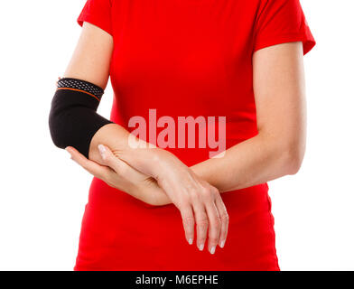 Tennis elbow - woman holding painful elbow isolated on white background - Stock Photo