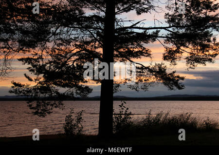 Sunset by Orsa lake in summer. - Stock Photo
