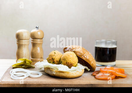 Vegan burger ingredients on wood table - Stock Photo