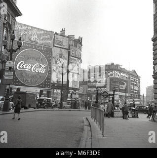 1960s, London, historical view of Piccadilly Circus and its famous advertising hoardings, from Regent Street. - Stock Photo