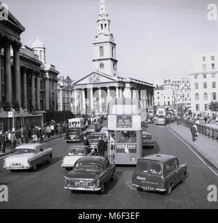 1960s, London, England, road traffic going past the National Gallery at Trafalgar Square and headed for the Strand - Stock Photo