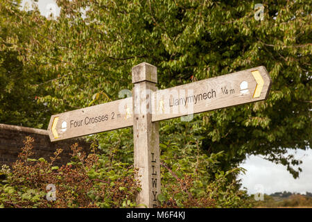 Waymarker / sign post showing directions on the Offa's Dyke long distance footpath near Llanymynech Wales - Stock Photo