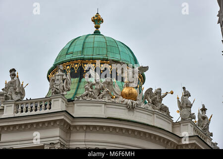 Ornate domed roof and statues on roofline of the Imperial Hofburg Palace St Michael's Wing Vienna - Stock Photo