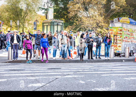 New York City, USA - October 28, 2017: Midtown Manhattan with happy young people crossing street of Columbus Circle - Stock Photo