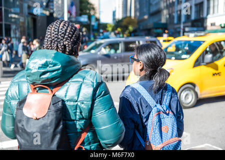 New York City, USA - October 28, 2017: Closeup portrait of two African American girls, women, mother, daughter family - Stock Photo