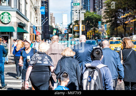New York City, USA - October 28, 2017: Midtown Manhattan with crowd crowded many people crossing street Columbus - Stock Photo