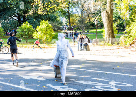 New York City, USA - October 28, 2017: Manhattan NYC Central park with artist woman person pantomime in white makeup - Stock Photo