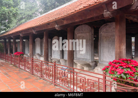 Names of Chinese scholars carved into stones at Văn Miếu Quốc Tử Giám (Temple of Literature) in Hanoi, Vietnam - Stock Photo