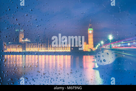 Big Ben view through the window with raindrops at night, London, UK. - Stock Photo