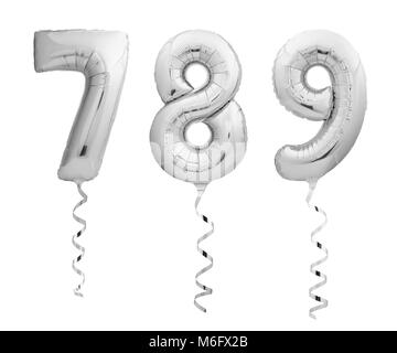Silver numbers 7, 8, 9 made of inflatable balloons with ribbons isolated on white background - Stock Photo