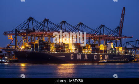ROTTERDAM - JUL 9, 2012: Container ship being unloaded in the Port of Rotterdam. - Stock Photo