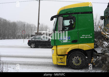 ABN truck driving in the snow delivering farm produce towards Salisbury on the A36 in treacherous conditions . - Stock Photo