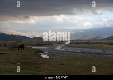 Nomadic Kazakh lifestyle in the vast, remote Altai Mountains in western Mongolia. - Stock Photo