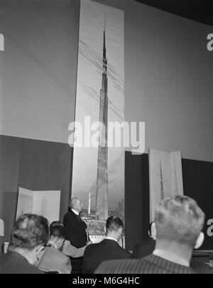 Frank Lloyd Wright unveils a 22-foot-high drawing of mile-high building he proposes for Chicago. October 16, 1956. - Stock Photo