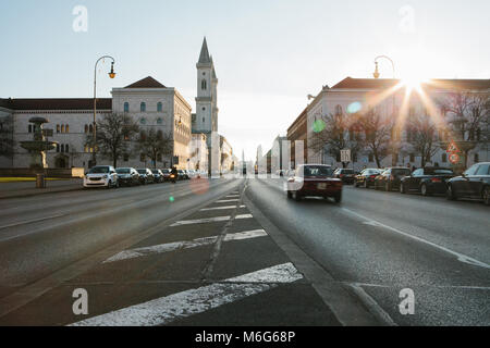 View of the road on the street Leopoldstrasse in Munich - the capital of Bavaria in Germany. Fast blurred motion - Stock Photo