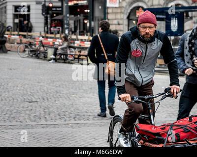 Copenhagen - October 17, 2016: A unidentified danish man riding a cargo bike in the center of Copenhagen. - Stock Photo
