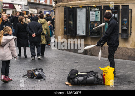 Copenhagen - October 17, 2016: A street juggler is making some moves for the pedestrians and the tourists - Stock Photo