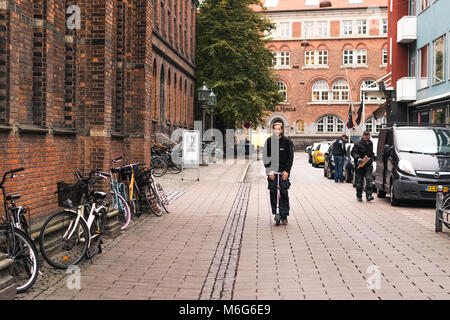 Copenhagen - October 17, 2016: A man with his tricycle on the Norregade street. - Stock Photo