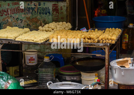 Street taro for sale, snacks which contain boiled quails eggs, pork or beef, wrapped in flour and potato, and deep - Stock Photo