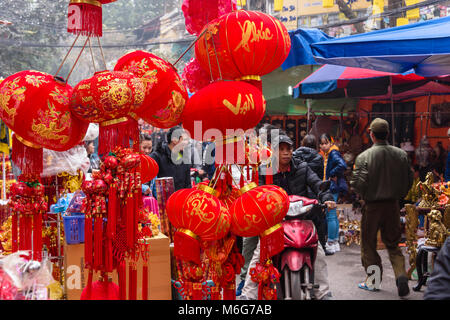 Goods to celebrate the Chinese new year on sale in 'Paper Street' in Hanoi, Vietnam - Stock Photo