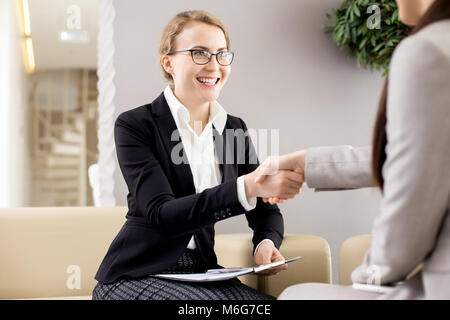 Firm Handshake of Business Partners - Stock Photo
