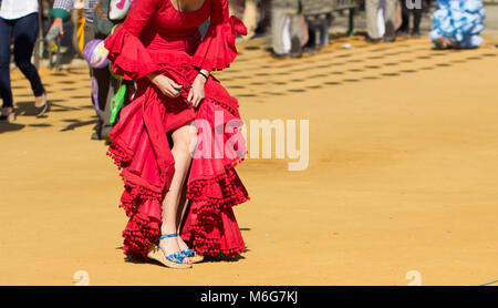 woman wearing traditional red flamenco dress - Stock Photo