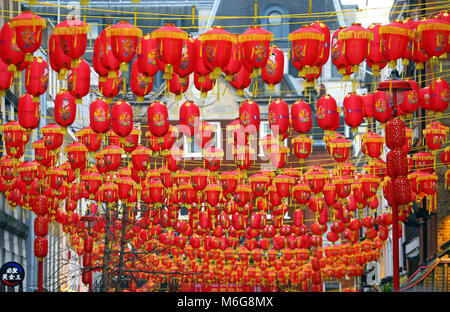 Traditional red Chinese lanterns strung across Gerrard Street in Chinatown for Chinese New Year, Year of the Dog - Stock Photo