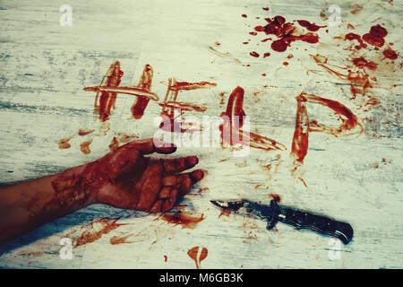 Says help, written in red blood on the dirty white floor of the bloody hand. The murder victim asks for help. - Stock Photo