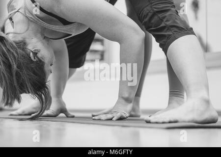 Novokuzneck, Russia, 30.01.2018: yoga class training, morning exercises in white interior - Stock Photo