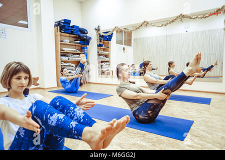 Novokuzneck, Russia, 30.012018 yoga class training morning exercises in white interior - Stock Photo