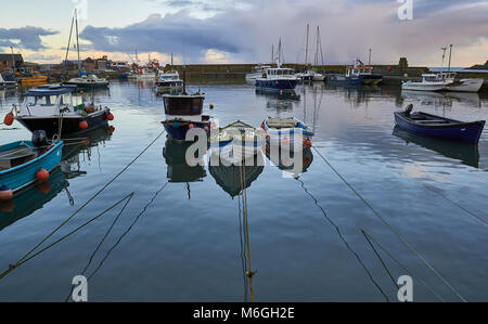 Fishing Boats and Pleasure Craft Float in the Inner Harbour at Stonehaven, an Old fishing Town on the East Coast - Stock Photo