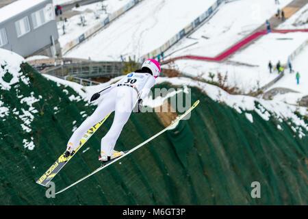 March 4, 2018: Yuka Seto (JPN)  during the  FIS Ski Jumping World Cup Ladies Rasnov (ROU) 2018 at Valea Carbunarii, - Stock Photo