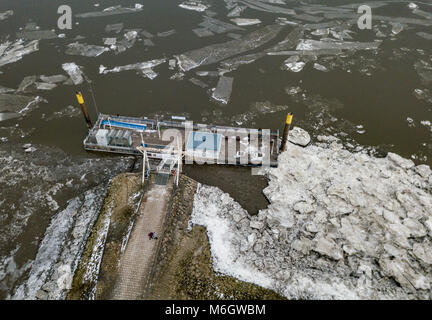 04 March 2018, Germany, Hamburg: Ice floes and pack ice surround a ferry terminal atthe Elbe river in front of the - Stock Photo